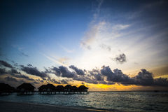 Villas at sunset, Maldives Royalty Free Stock Images