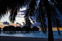 Villas at sunset, Maldives Stock Photo