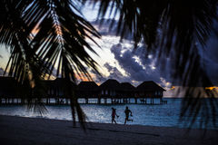 Villas at sunset, Maldives Stock Images