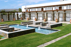 Villas with swimming-pool and fontains. Royalty Free Stock Photography