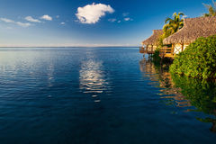 Villas in a tropical resort and blue sky reflected in the blue o Royalty Free Stock Photo