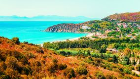 Villasimius Beach in Mediterranean Sea on Sardinia Island in Italy. Shore of Beautiful Villasimius Beach at the Bay of the Blue Waters in the Mediterranean Sea royalty free stock images