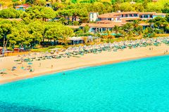Villasimius Beach at Mediterranean Sea at Sardinia Island in Italy. Shore of Beautiful Villasimius Beach at the Bay of the Blue Waters of the Mediterranean Sea stock photography