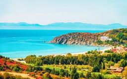 Villasimius Beach at Mediterranean Sea on Sardinia Island in Italy. Shore of Beautiful Villasimius Beach at the Bay of the Blue Waters of the Mediterranean Sea stock photos