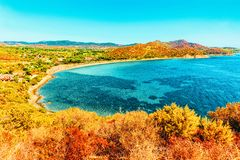 Villasimius Beach in Mediterranean Sea on Sardinia Island Italy. Shore of Beautiful Villasimius Beach at the Bay of the Blue Waters in the Mediterranean Sea on stock images