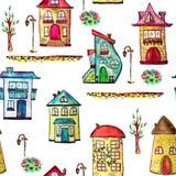 Ville d'aquarelle avec les maisons féeriques et confortables Texture sans couture avec des bâtiments, des arbres, et des lampes F illustration stock