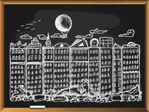 Ville de conte de fées sur le fond de tableau noir Photographie stock libre de droits