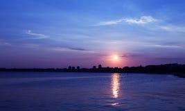 Ville de coucher du soleil de mer Image stock