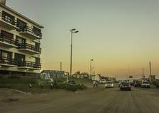 Ville de Pinamar au coucher du soleil Images libres de droits