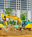 Ville industrielle Singapour de bouteur d'excavatrices Photographie stock