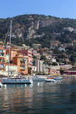Villefranche Harbor. Villefranche, France - June 9, 2014 - Businesses open in the morning to serve hoards of tourists arriving by cruise ship. The hospitality royalty free stock images
