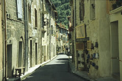 Villefranche-medieval alley. The little village Villefranche, France, preserves the medieval view with old stonewalled houses and romantic alleys Royalty Free Stock Images