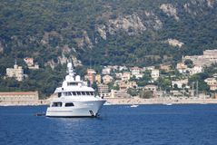 Villefranche-sur-Mer, passenger ship, water transportation, boat, yacht. Villefranche-sur-Mer is passenger ship, yacht and watercraft. That marvel has water stock photo