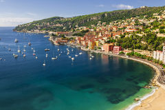 Villefranche-sur-Mer view on French Riviera. Aerial view of picturesque French Riviera mediterranean coast with medieval town Villefranche-sur-Mer, sandy beach Stock Photos