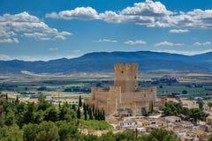 Villena Castle in Costa Blanca Alicante Spain. Long shot of Villena Castle against plain and mountain range. Villena is the part of Route of the Castles Stock Photos