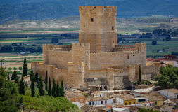 Villena Castle in Costa Blanca Alicante Spain. Long shot of Villena Castle against plain and mountain range. Villena is the part of Route of the Castles Stock Images