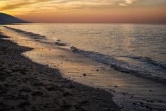 Villers-sur Mer-Strand bei Sonnenuntergang stockfoto