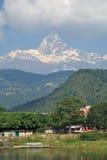 Villiage under fish tail mountain royalty free stock photo