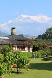 Villiage under Himalayan mountain stock images
