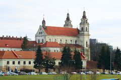 Vilnius archangel church on the board river Neris Stock Photography