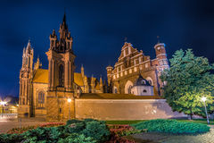 Vilnius church at night and yard with flowers. Saint Anne Church in Vilnius, Lithuania. Night scene of lovely Europe town, wide angle Royalty Free Stock Images