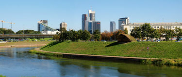 Vilnius city center shot from Neris river board Royalty Free Stock Photos