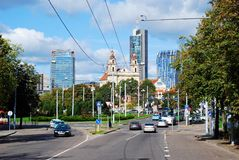 Vilnius city center street with cars and houses Royalty Free Stock Photo