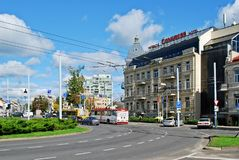 Vilnius city center street with cars and houses Royalty Free Stock Photos