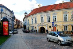 Vilnius city center street with cars and houses Royalty Free Stock Image