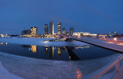 The Vilnius city - Lithuania. Reflections in the Neris river. Walking bridge in the city Royalty Free Stock Photos