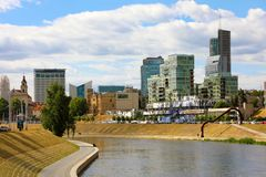 Vilnius City with modern buildings and the Neris river Vilnius, Lithuania, Baltic States, Europe.  Stock Photos