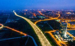 Vilnius city night, drone photo. Aerial road view at night, Lithuania Vilnius royalty free stock image