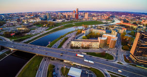 Vilnius city. Vilnius with river Neris at sunset. City scape with road and busy street stock image