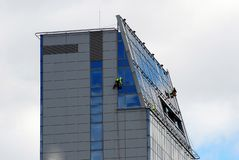 Vilnius city skyscraper cleaners at work on September 24, 2014 Royalty Free Stock Photo