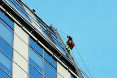 Vilnius city skyscraper cleaners at work on September 24, 2014 Stock Image