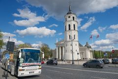 Vilnius City Tour bus stopped at the Cathedral square in Vilnius, Lithuania. Royalty Free Stock Photography
