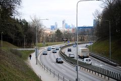 Vilnius city transport in the Gelezinis Vilkas street. VILNIUS, LITHUANIA - MARCH 13: Vilnius city transport in the Gelezinis Vilkas (Iron Wolf) street 13, 2015 Royalty Free Stock Image