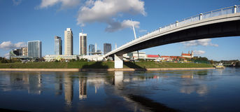 The Vilnius city walking bridge with skyscrapers Royalty Free Stock Photos