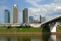The Vilnius city walking bridge with skyscrapers Stock Images