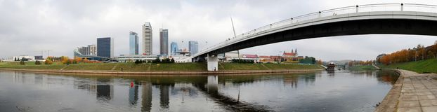 The Vilnius city walking bridge with skyscrapers. Royalty Free Stock Photo