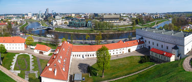 Vilnius Cityscape. Panoramic view of Vilnius city in Lithuania, with historical architectural structures, buildings around, with a flowing river, on blue clear Stock Images