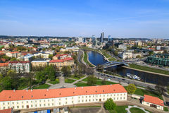 Vilnius Cityscape. View of Vilnius city in Lithuania, with historical architectural structures, buildings around, with a flowing river, on blue clear sky Stock Images