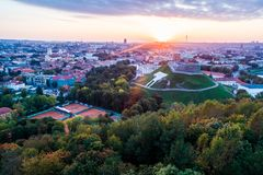 Vilnius Gediminas castle from above. Aerila flight in fall sunset stock image