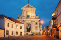 Vilnius Lithuania. Ancient Baroque Catholic Church Of St. Teresa. Vilnius, Lithuania. View Of Ancient Early Baroque Catholic Church Of St. Teresa On Illuminated Royalty Free Stock Photo