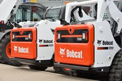 Bobcat heavy duty equipment vehicle and logo Stock Images