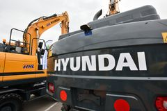 Hyundai Excavator and logo Royalty Free Stock Photo