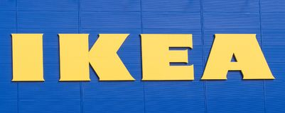 Vilnius, Lithuania - April 19, 2019: IKEA logo of company on facade of company store of furniture for home and coziness royalty free stock images