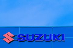 Vilnius, Lithuania- April 12, 2018: Suzuki dealership sign on the wall. Suzuki is a Japanese multinational corporation stock photo