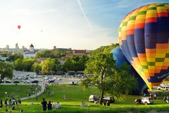 VILNIUS, LITHUANIA - AUGUST 15, 2018: Colorful hot air balloons taking off in Old town of Vilnius city on sunny summer evening. Lots of people watching as royalty free stock photo