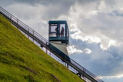 VILNIUS, LITHUANIA - AUGUST 15, 2016: People ride in the Funicular to Gediminas Hill in Vilnius, Lithuani. A stock photography